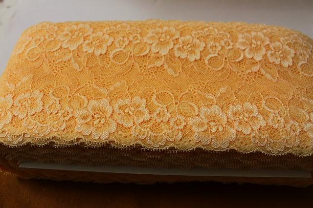 画像1: 送料無料!58m!幅14cm花とリボン柄ラッセルストレッチレース ソフトオレンジ (1)